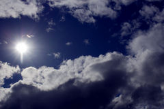 The sky. Gloomy weather with the sun Stock Images