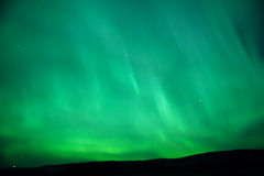 The sky glowing green - Aurora Borealis Stock Photos