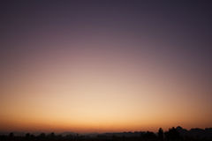 Sky gradient. From blue to orange sunset Stock Photos