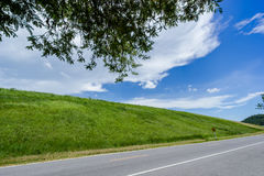 Sky with green fields. Bang Phra, Chonburi, Thailand Royalty Free Stock Photo