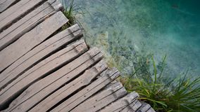 Wooden pathway over clear water in Plitvice National Park royalty free stock image