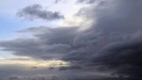 Sky with gray clouds. Time lapse with storm clouds