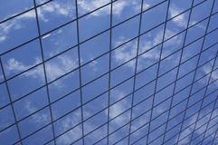 Sky Grid. A part of skyscraper, which makes reflected sky looks like in grid Royalty Free Stock Photo