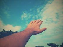 Sky. Hand toward sky stock image