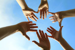 Sky and hands. Blue sky and people hands Stock Photos