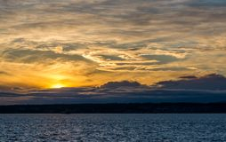 Eerie Sunset Landscape. The sky has an eerie look as the sun set behind the Puget Sound stock photography