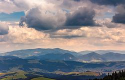 Sky with heavy clouds over the mountain ridge. Beautiful summertime landscape stock photo