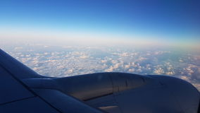 Sky High in the air. Airplane engine wing in the cloud Stock Images
