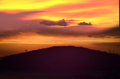 Sky and Hill. Sunset over mountains with orange sky royalty free stock photography
