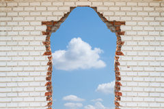 Sky hole in aged brick wall background Stock Image