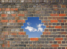 Sky through a hole in a brick wall Royalty Free Stock Photography