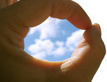 Sky in the hole of hand Royalty Free Stock Image