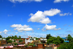 Sky and houses. Beautiful shot of blue sky and houses Stock Photo