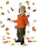 The Sky if Falling. An adorable preschooler dressed in autumn colors wondering concerned that all the leaves are falling down.  On a white background Royalty Free Stock Images