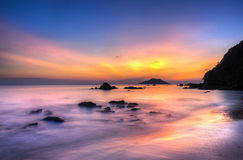 Sky island and sea at sunset. Stock Photo