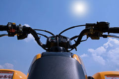Sky Jumping ATV. An ATV, four wheeler handle bars pointed at the blue sky Royalty Free Stock Image
