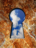 Sky in a keyhole Royalty Free Stock Photo