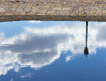 Sky and lamppost reflected in the water. Reflection Royalty Free Stock Photo