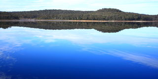 Reflections of sky and landscape in lake Stock Image