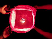 Burning of hand held sparkle firework in black background.  royalty free stock images