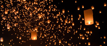 Sky lanterns on black sky. Floating lanterns ceremony or Yeepeng ceremony, traditional Lanna Buddhist ceremony in Chiang Mai, Thailand Royalty Free Stock Photos