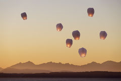 Sky lanterns flying upwards Stock Photo