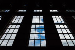The sky through the large panoramic windows. Of an abandoned building stock images