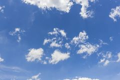 White clouds in blue sky background. Sky from Latin caelum, from caelum tangi: being-touched-wounded by lightning is often defined as the space in which the royalty free stock photography