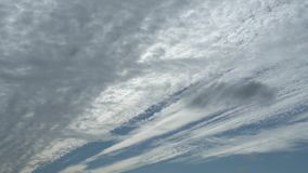 Layers of clouds moving in different directions. Relaxing view of moving transforming clouds. Full HD Time Lapse