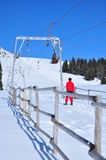 On the sky lift. Image of a skier on a ski installation in Surianu sky resort, Romania Royalty Free Stock Photo