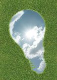 Sky in lightbulb shape on grass Royalty Free Stock Photos
