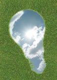 Sky in lightbulb shape on grass Royalty Free Stock Photos