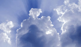 Sky lights and colors. Beautiful nature image of cloudy sky with hidden sunlights Stock Photo