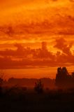 Sky like fire. Over field with hay Royalty Free Stock Photo