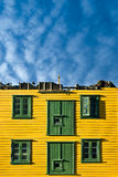 The sky is the limit. Old wooden building missing roof with nice sky after fire in Bergen Stock Images