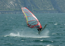 The Sky Is The Limit!. Windsurfer jumps out of the water, cool shot. Taken in Italy at the Garda Lake stock photography