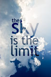 The sky is the limit. Quote written on a blue sky with while clounds on a sunny day vector illustration