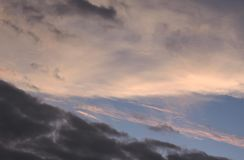Sky line. At sunset with storm clouds rolling in, in the distance. Pinks, blues, and dark grays fill the sky royalty free stock photo