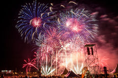 A sky lit up with fireworks Royalty Free Stock Images