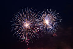 A sky lit up with fireworks Stock Images