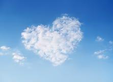 Sky of love. Heart shaped cloud on beautiful blue sky Stock Photo