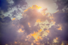 Sky with majestic dark clouds, light rays and sun flare Royalty Free Stock Photos