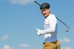 The sky a man playing golf and shows class. Golfer showing thumbs up against the sky Royalty Free Stock Photos
