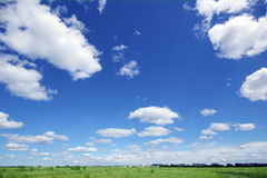 Sky, meadow and houses in the distance Stock Photo