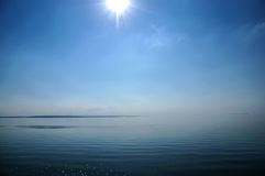 The sky merges with the sea. The morning mist at sea. The sky merges with the sea stock images