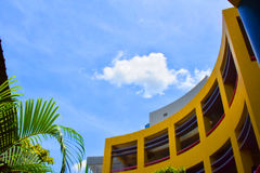 The sky and the modern facade. The skyline over the roof of a modern yellow building Royalty Free Stock Photo