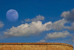 Sky, moon, wall. Sky, moon and red brick wall royalty free stock images