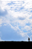 Sky and Mountain. A man walking on the mountain Stock Image
