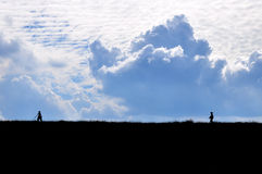 Sky and Mountain. People walking on the mountain Royalty Free Stock Photo