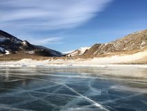 The sky, the mountains, and ice on the Lake Baikal Royalty Free Stock Photography